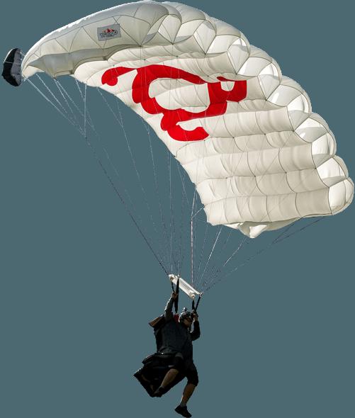 картинка с Глебом Вареводиным висящем на парашюте